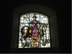 Love the stained glass. Don't know who he is. LOL.