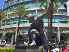 "A miniature of the ""False Gods"" statue from ""Batman v. Superman: Dawn of Justice"" knelt outside the convention center."